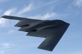 The batshaped B2 stealth bomber with its flying wing design flies over Whiteman Air Force Base May 8 2003 near Knob Noster Missouri Whiteman is the...
