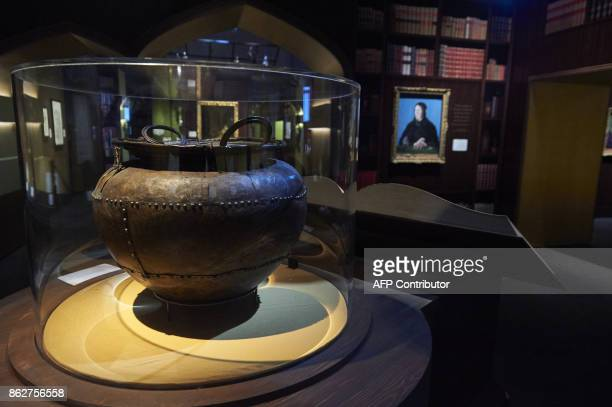 The Battersea Cauldron is displayed during a preview of 'Harry Potter A History of Magic' exhibition at the British Library in central London on...