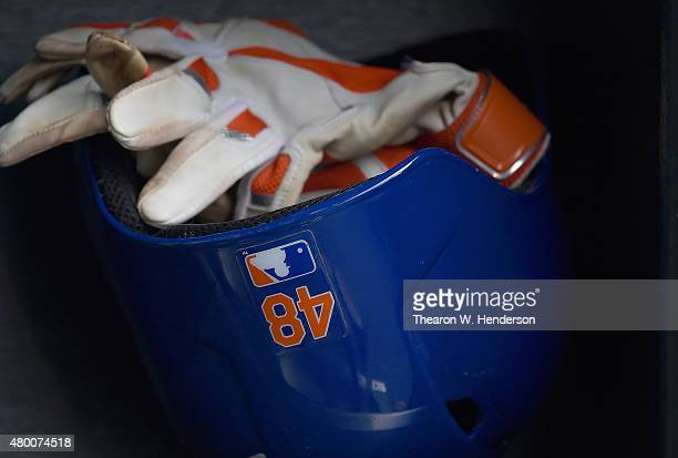 The batting helmet and batting gloves belonging to Jacob deGrom of the New York Mets sits in the rack prior to the game against the San Francisco...