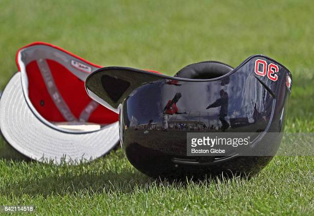 The batting helmet of Boston Red Sox outfielder Chris Young rests on the ground during day four of spring training at Jet Blue Park in Fort Myers FL...