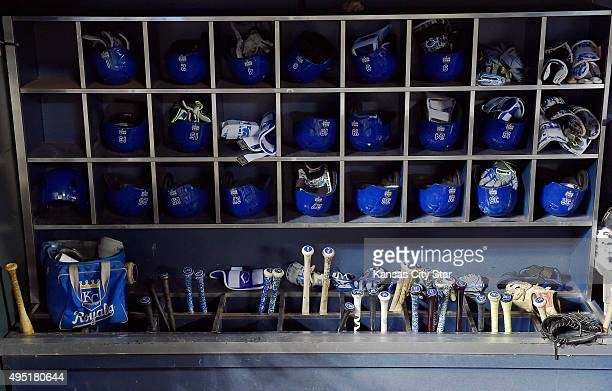 The batting helmets gloves and bats of the Kansas City Royals are ready to go in the dugout before Game 4 of the World Series against the New York...