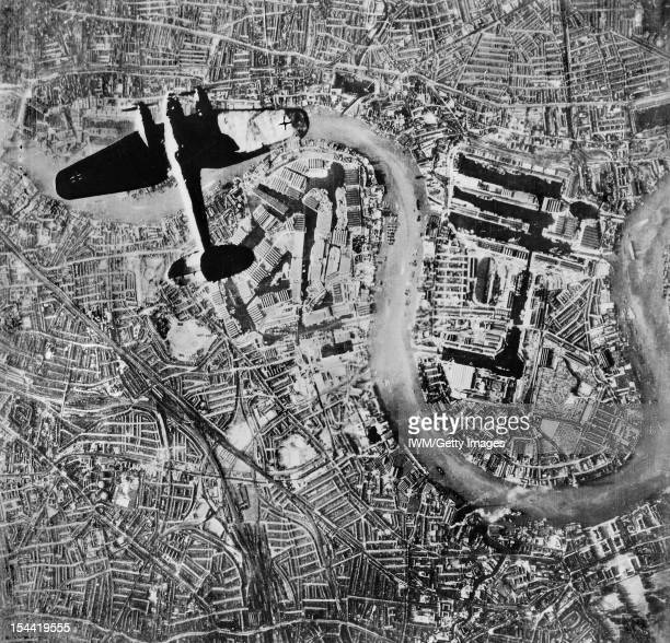 The Battle Of Britain A Heinkel He 111 bomber flying over the Isle of Dogs in the East End of London at at the start of the Luftwaffe's evening raids...