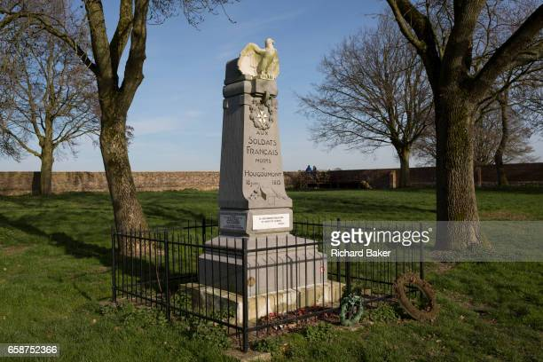 The battlefield memorial inside the walled Hougoumont Farm to the soldiers of Napoleon's Grande Armee killed at Waterloo on 25th March 2017 at...