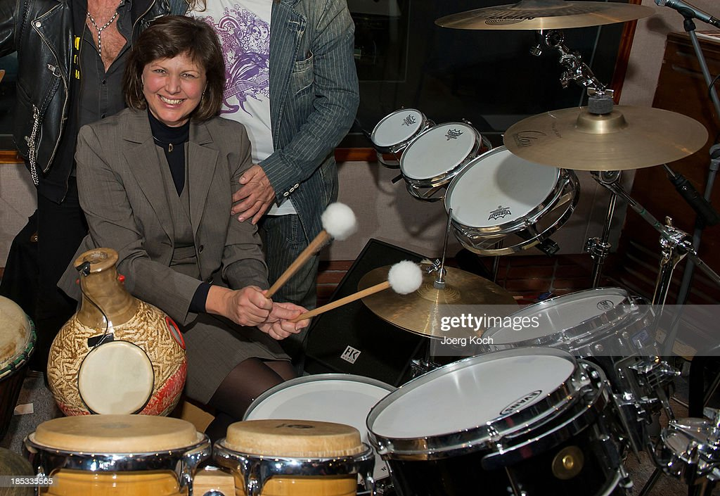 The bavarian minister for economic affairs, Ilse Aigner (CSU) poses with drums during a get-together for the launch of Leslie Mandokis new Album 'BudaBest' on October 18, 2013 in the Red Rock Studios in Tutzing near Munich, Germany. Mandoki recorded the new album in Budapest featuring Jack Bruce (Cream), Bobby Kimball (Toto), Chris Thompson (former Manfred Mann`s Earth Band), John Helliwell (Supertramp) and Peter Maffay.