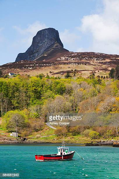 The bay at Galmisdale on the Isle of Eigg, Scotland, UK, looking towards the iconic An Sgurr peak.