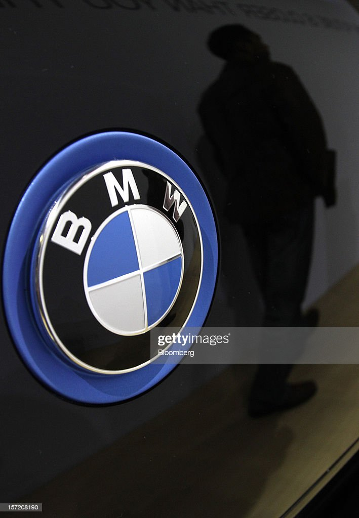 The Bayerische Motoren Werke AG (BMW) logo is displayed at the LA Auto Show in Los Angeles, California, U.S., on Thursday, Nov. 29, 2012. The LA Auto Show is open to the public Nov. 30 through Dec. 9. Photographer: Jonathan Alcorn/Bloomberg via Getty Images