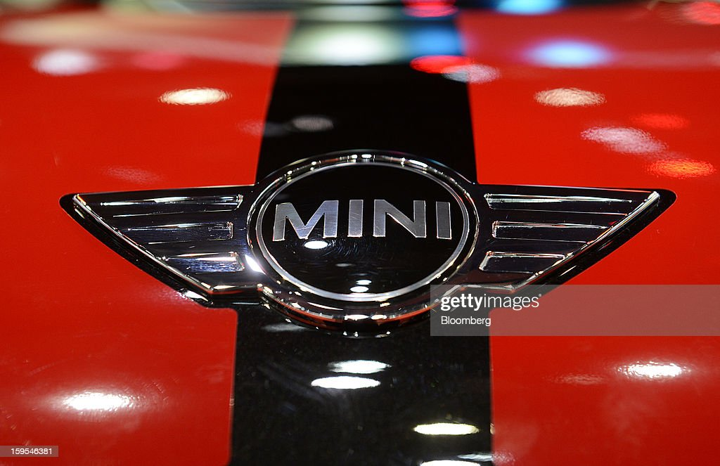 The Bayerische Motoren Werke AG (BMW) Mini Cooper logo is seen on a vehicle during the 2013 North American International Auto Show (NAIAS) in Detroit, Michigan, U.S., on Tuesday, Jan. 15, 2013. The Detroit auto show runs through Jan. 27 and will display over 500 vehicles, representing the most innovative designs in the world. Photographer: David Paul Morris/Bloomberg via Getty Images