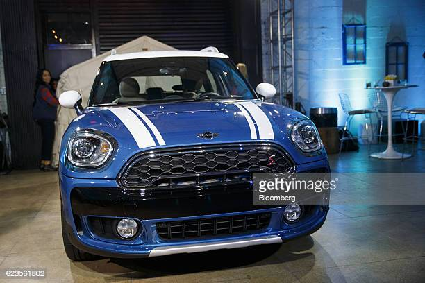 The Bayerische Motoren Werke AG MINI Countryman compact sports utility vehicle sits on display after being unveiled during an event in Los Angeles...