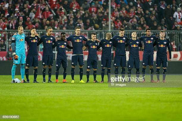 The Bayern Muenchen and RB Leipzig team observe a minute's silence to remember the victims of the Berlin attack during the Bundesliga match between...