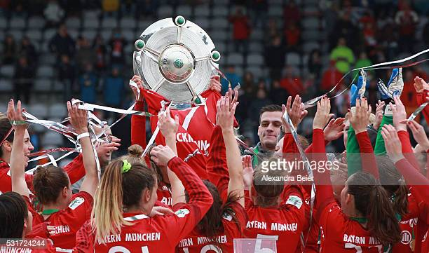 The Bayern Muenchen women team celebrates their German Championship victory holding up the trophy after the women Bundesliga match between FC Bayern...