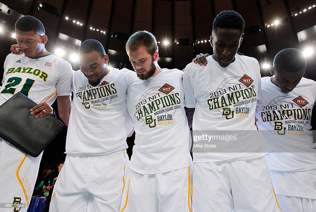 The Baylor Bears pray following their victory against the Iowa Hawkeyes during the 2013 NIT Championship at Madison Square Garden on April 4, 2013 in New York City. Baylor defeated Iowa 74-54.