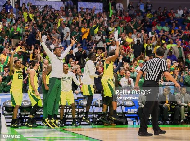 The Baylor bench celebrates as the clock nears zero during the NCAA men's basketball tournament game between the Baylor Bears and the New Mexico...