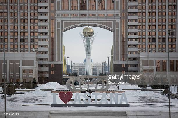 The Bayterek tower monument center stands beyond the headquarter offices of KazMunaiGaz National Co the stateowned oil and gas company in Astana...