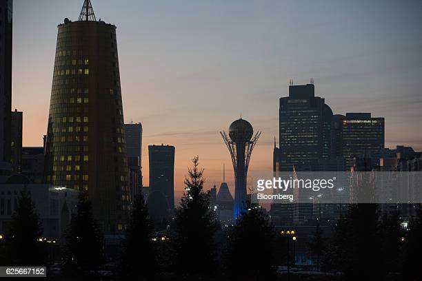 The Bayterek tower monument center stands flanked by skyscrapers in Astana Kazakhstan on Tuesday Nov 22 2016 Kazakhstan's central bank is planning to...