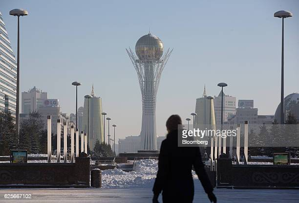 The Bayterek tower monument center stands flanked by the golden twin towers of Ministries House in Astana Kazakhstan on Tuesday Nov 22 2016...