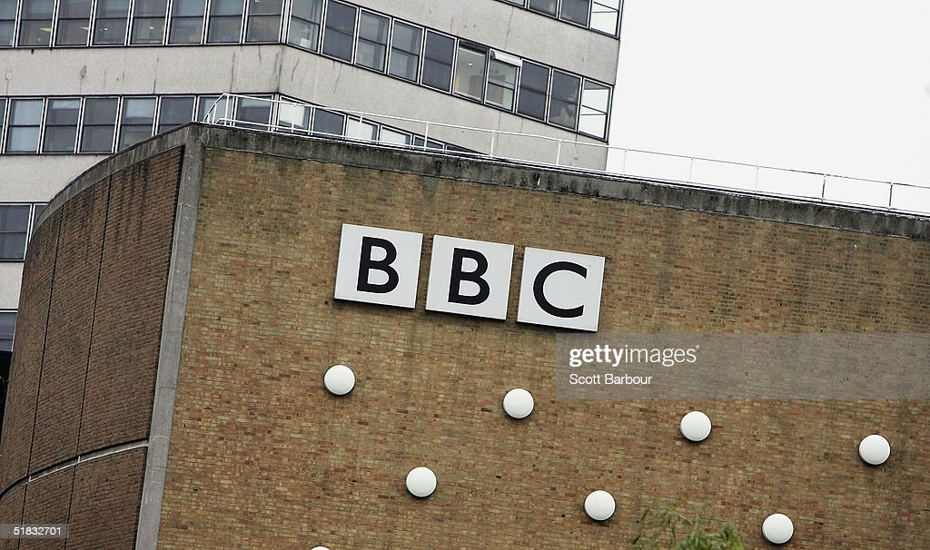 The BBC logo sits on a wall at the BBC headquarters on December 7, 2004 in London, England. About 2,900 jobs are expected to be cut at the British Broadcasting Corporation, resulting in savings that are needed so that more of the money from licence fees can be put into programmes.