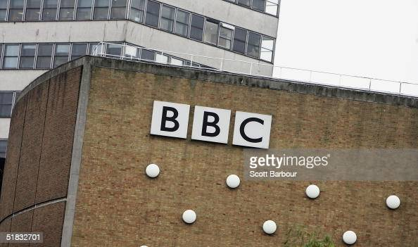 The BBC logo sits on a wall at the BBC headquarters on December 7 2004 in London England About 2900 jobs are expected to be cut at the British...