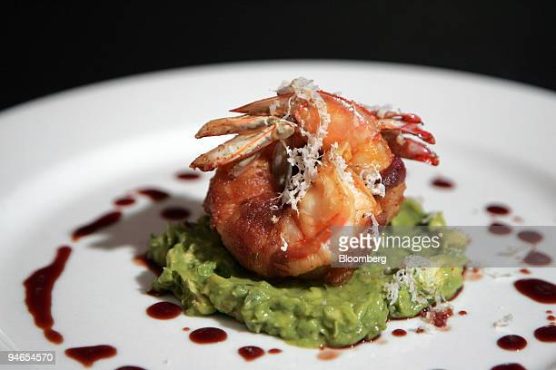 The BBQ Shrimp Wrapped in Bacon with Avocado Cocktail Sauce is arranged at Johnny Utah's in Rockefeller Center New York on Aug 10 2007 Johnny Utah's...