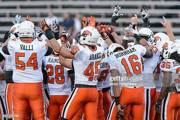The BC Lions encourage each other during the CFL game against the Montreal Alouettes at Percival Molson Stadium on September 3 2015 in Montreal...