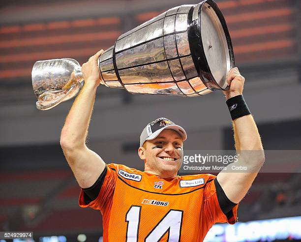 The BC Lions quarterback Travis Lulay raises the Grey Cup after the Lions defeated the Winnipeg Blue Bombers 3423 at the Canadian Football League...