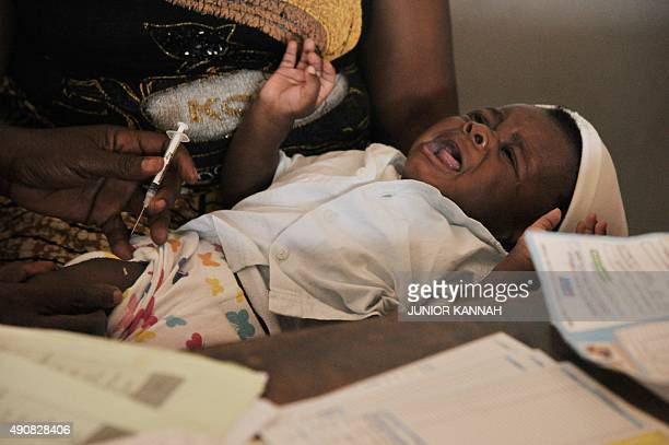 The BCG vaccine against tuberculosis provided by UNICEF is administered to a baby at the Noki health centre on September 10 2015 AFP PHOTO/JUNIOR...