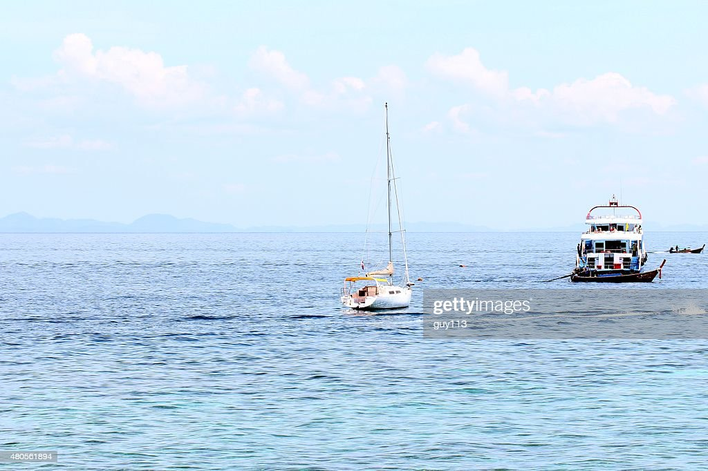 The beach and boat : Stock Photo