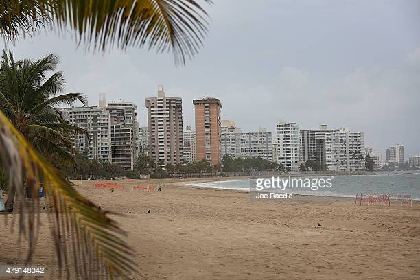 The beach is empty on July 1 2015 in San Juan Puerto Rico The island's residents are dealing with increasing economic hardships and a financial...