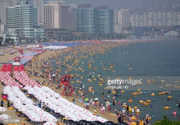 The beach of Haeundae in South Korea's southern port city of Busan is crowded with holidaymakers on August 22 2010 Many South Koreans visit beaches...