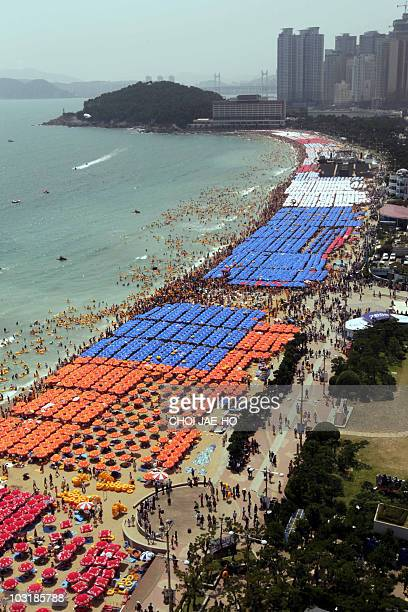 The beach of Haeundae in South Korea's southern port of Busan is crowded with holidaymakers on August 1 2010 Many South Koreans visited beaches and...