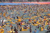 The beach of Haeundae in South Korea's southern port of Busan is crowded with holidaymakers on August 8 2010 Many South Koreans visited beaches and...