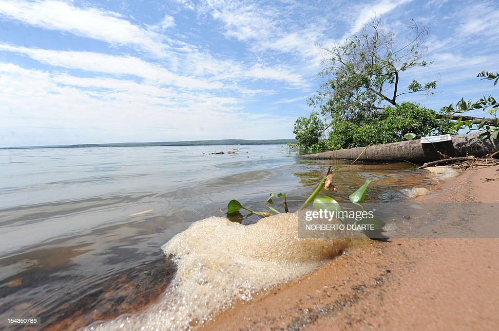 The beach of the Ypacarai Lake, declared not suitable for bathing, in Ypacarai, Paraguay on October 18, 2012. Paraguay's Health Minister Antonio Corbo said that water samples from the lake analized in Sao Paulo, Brazil with the backing of the Pan American Health Organization determined that the bacteria found in the lake's waterweed present a high level of neurologic and liver toxicity.