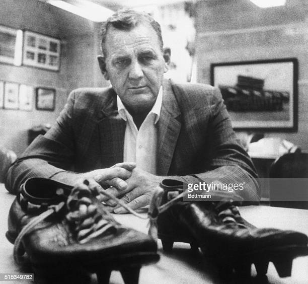 The Bear has a big pair of shoes to fill Paul 'Bear' Bryant coach of the national football champions of the Univ of Alabama looks at the shoes worn...