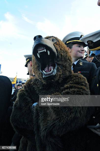 The Bear Shark of the 25th Company of the Naval Academy is harassed in the stands on December 3 at Navy Marine Corps Memorial Stadium in Annapolis MD...