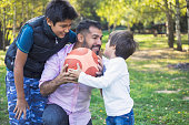 Father and sons have a fun in public park