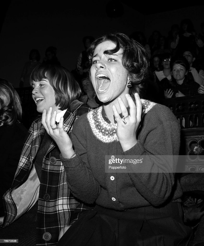 The Beatles 1964 US Tour A screaming American music fan is gripped by Beatlemania as the band perform on stage at Carnegie Hall New York during their...
