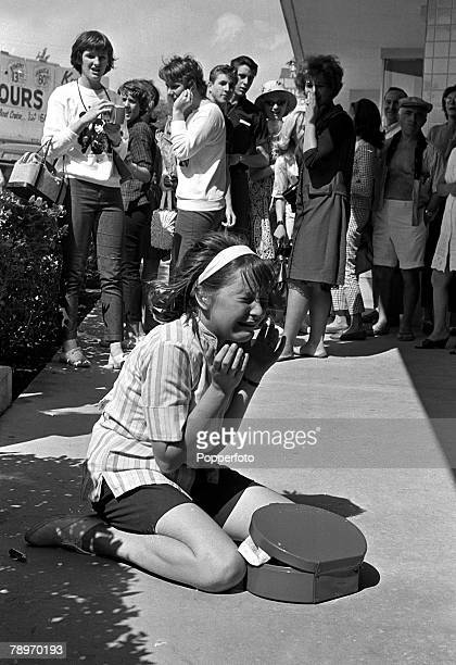 The Beatles 1964 US Tour A young American fan of British pop group The Beatles is overcome with emotion and cries uncontrollably as her heroes leave...