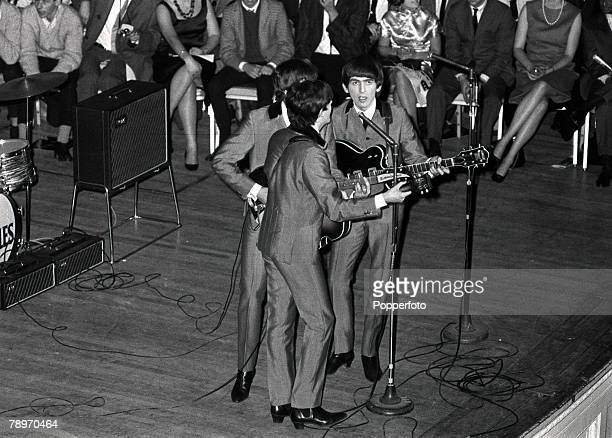 The Beatles 1964 US Tour Paul McCartney John Lennon and George Harrison of the British pop group The Beatles singing on stage during a concert at...