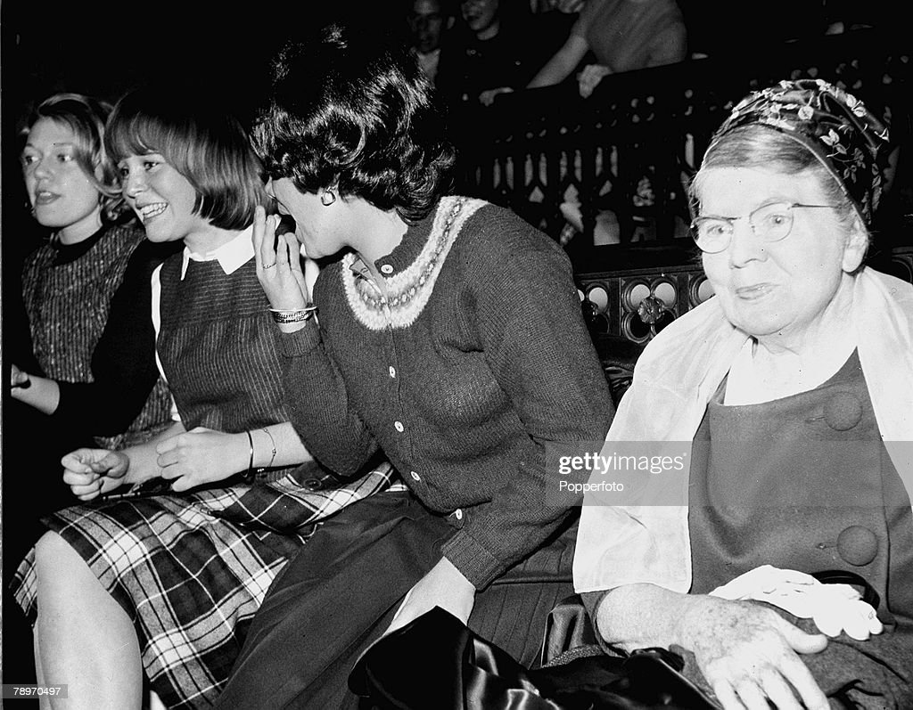 The Beatles 1964 US TourThree young American girl fans of British pop group The Beatles sit with an elderley lady at Carnegie Hall during a Beatles...