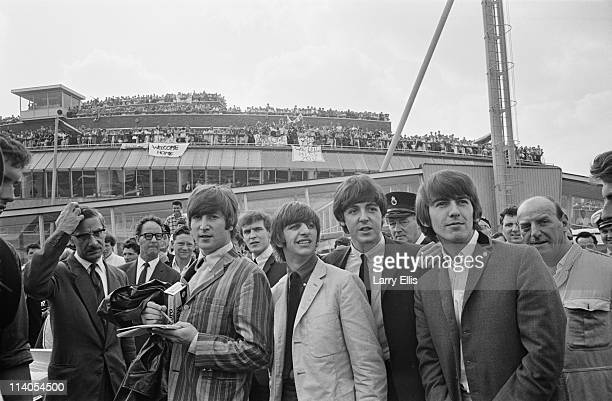 The Beatles arrive at London Airport after a flight from Stockholm in Sweden 30th July 1964 From left to right John Lennon Ringo Starr Paul McCartney...