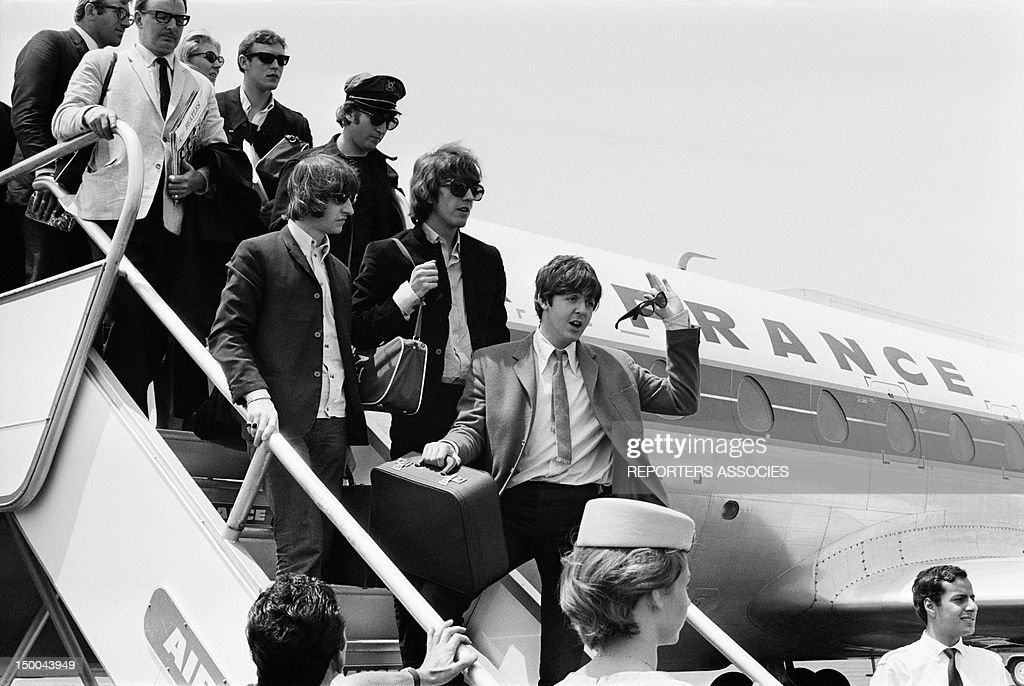 The Beatles arrive at Nice airport on June 30, 1965 in Nice, France.