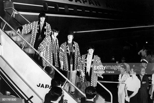 The Beatles arrive at Tokyo airport for their japanese tour in July 1966 in Tokyo Japan