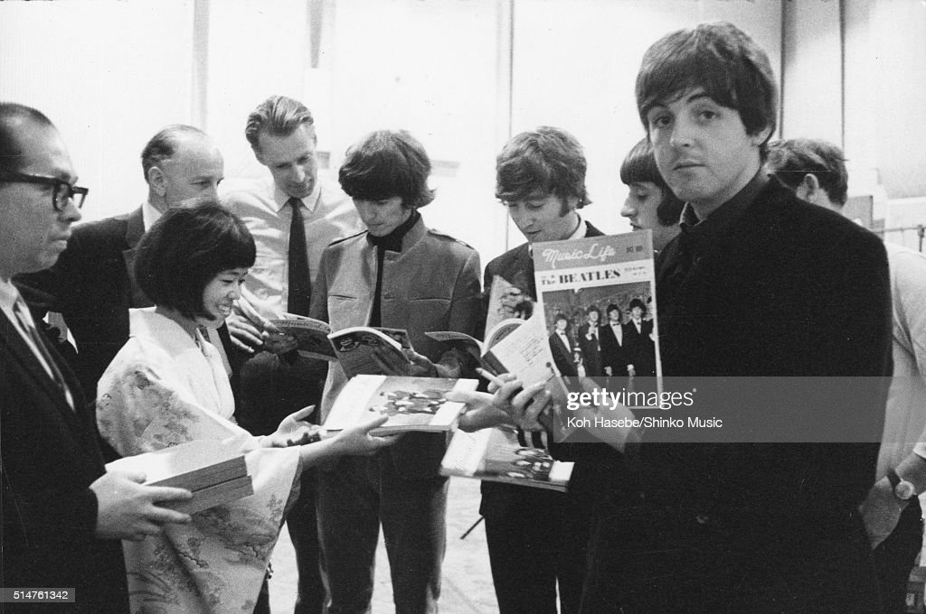 The Beatles at EMI Studios, Abbey Road, London during the recording session for 'It's Only Love', June 15, 1965. Left to right: Joe Miyasaki, Rumi Hoshika, unknown, George Martin, George Harrison, John Lennon, Ringo Starr and Paul McCartney.