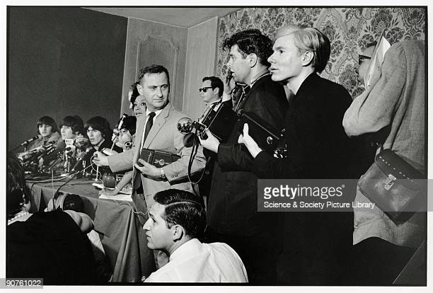 The Beatles being interveiwed by the media with Andy Warhol amongst the photographers Tony RayJones received an MFA diploma from the Yale University...