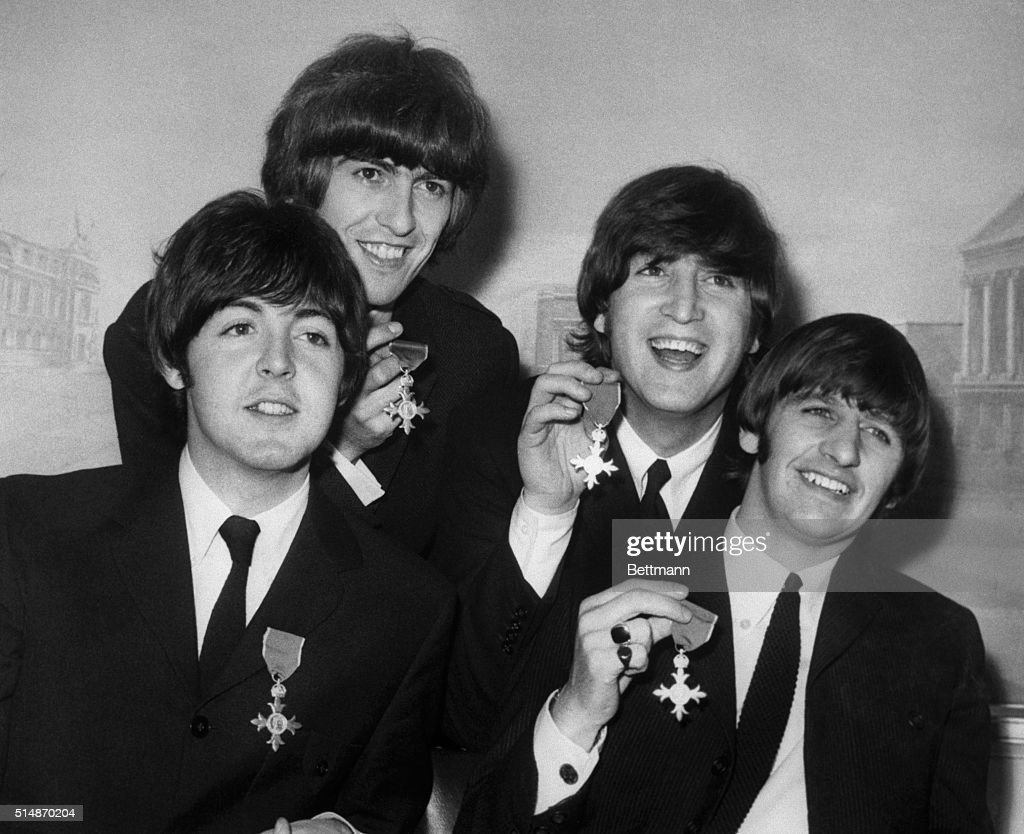 <a gi-track='captionPersonalityLinkClicked' href=/galleries/search?phrase=The+Beatles&family=editorial&specificpeople=90369 ng-click='$event.stopPropagation()'>The Beatles</a> display the medals they were awarded when Queen Elizabeth granted them membership in the Order of the British Empire at Buckingham Palace. From left to right: <a gi-track='captionPersonalityLinkClicked' href=/galleries/search?phrase=Paul+McCartney&family=editorial&specificpeople=92298 ng-click='$event.stopPropagation()'>Paul McCartney</a>, <a gi-track='captionPersonalityLinkClicked' href=/galleries/search?phrase=George+Harrison&family=editorial&specificpeople=90945 ng-click='$event.stopPropagation()'>George Harrison</a>, <a gi-track='captionPersonalityLinkClicked' href=/galleries/search?phrase=John+Lennon&family=editorial&specificpeople=91242 ng-click='$event.stopPropagation()'>John Lennon</a>, and <a gi-track='captionPersonalityLinkClicked' href=/galleries/search?phrase=Ringo+Starr&family=editorial&specificpeople=92463 ng-click='$event.stopPropagation()'>Ringo Starr</a>.