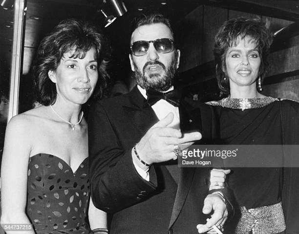 'The Beatles' drummer Ringo Starr with his wife Barbara Bach and Olivia Harrison wife of fellow Beatle George attending the premiere of the film 'A...