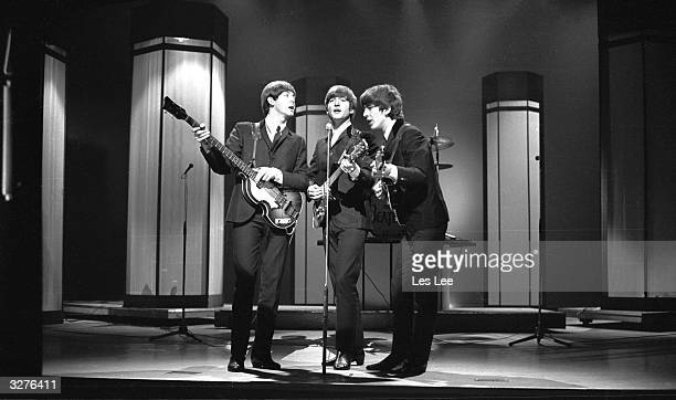 The Beatles from left to right Paul McCartney John Lennon and George Harrison in concert at the London Palladium