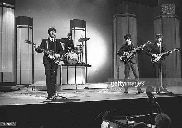 The Beatles from left to right Paul McCartney Ringo Starr George Harrison and John Lennon in concert at the London Palladium