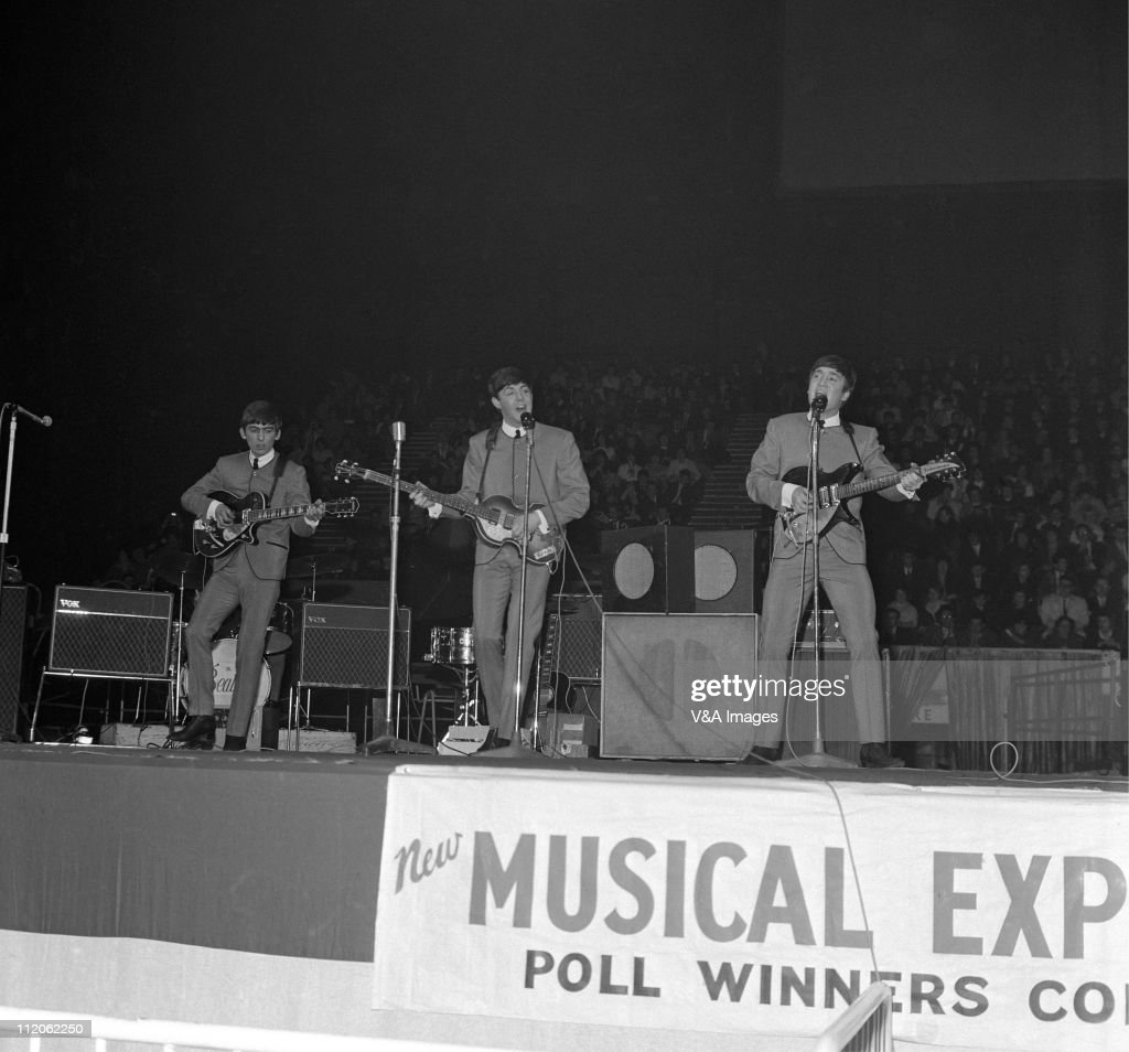 The Beatles George Harrison Paul McCartney John Lennon performs on stage at NME Poll Winners Concert Wembley Empire Pool 21 April 1963
