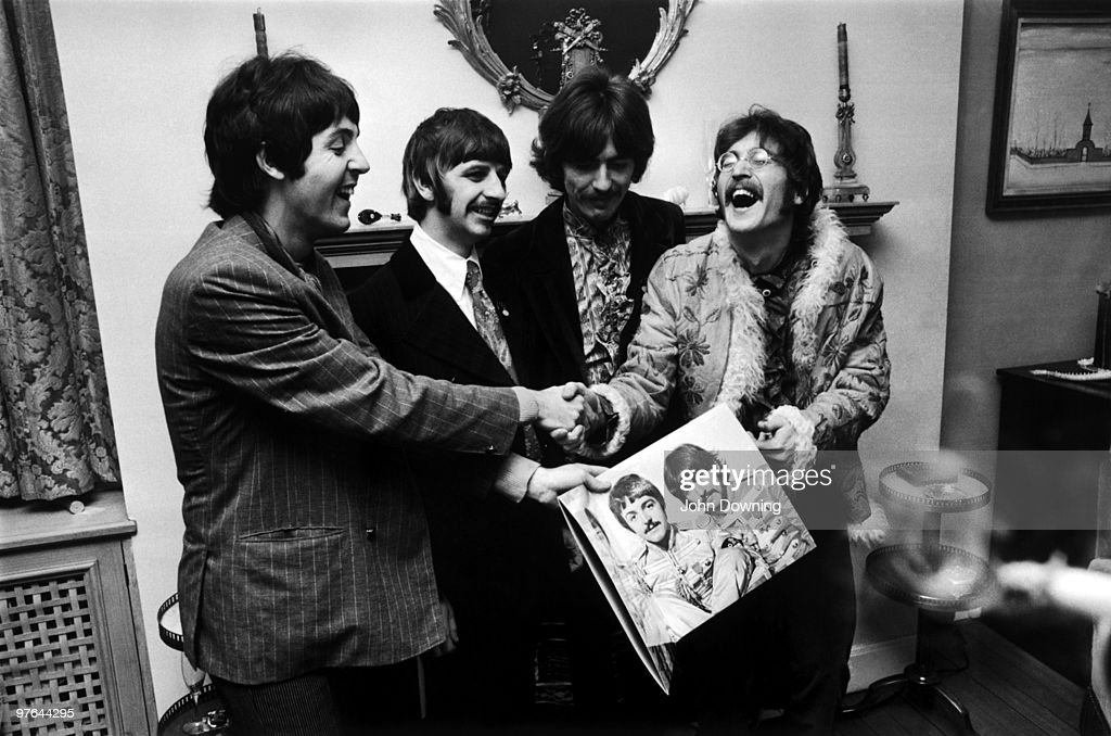 The Beatles (left to right) <a gi-track='captionPersonalityLinkClicked' href=/galleries/search?phrase=George+Harrison&family=editorial&specificpeople=90945 ng-click='$event.stopPropagation()'>George Harrison</a> (1943 - 2001), Ringo Starr, John Lennon (1940 - 1980) and <a gi-track='captionPersonalityLinkClicked' href=/galleries/search?phrase=Paul+McCartney&family=editorial&specificpeople=92298 ng-click='$event.stopPropagation()'>Paul McCartney</a>, hold the sleeve of their new LP, 'Sgt. Pepper's Lonely Hearts Club Band', at the press launch for the album, held at Brian Epstein's house at 24 Chapel Street, London, 19th May 1967.