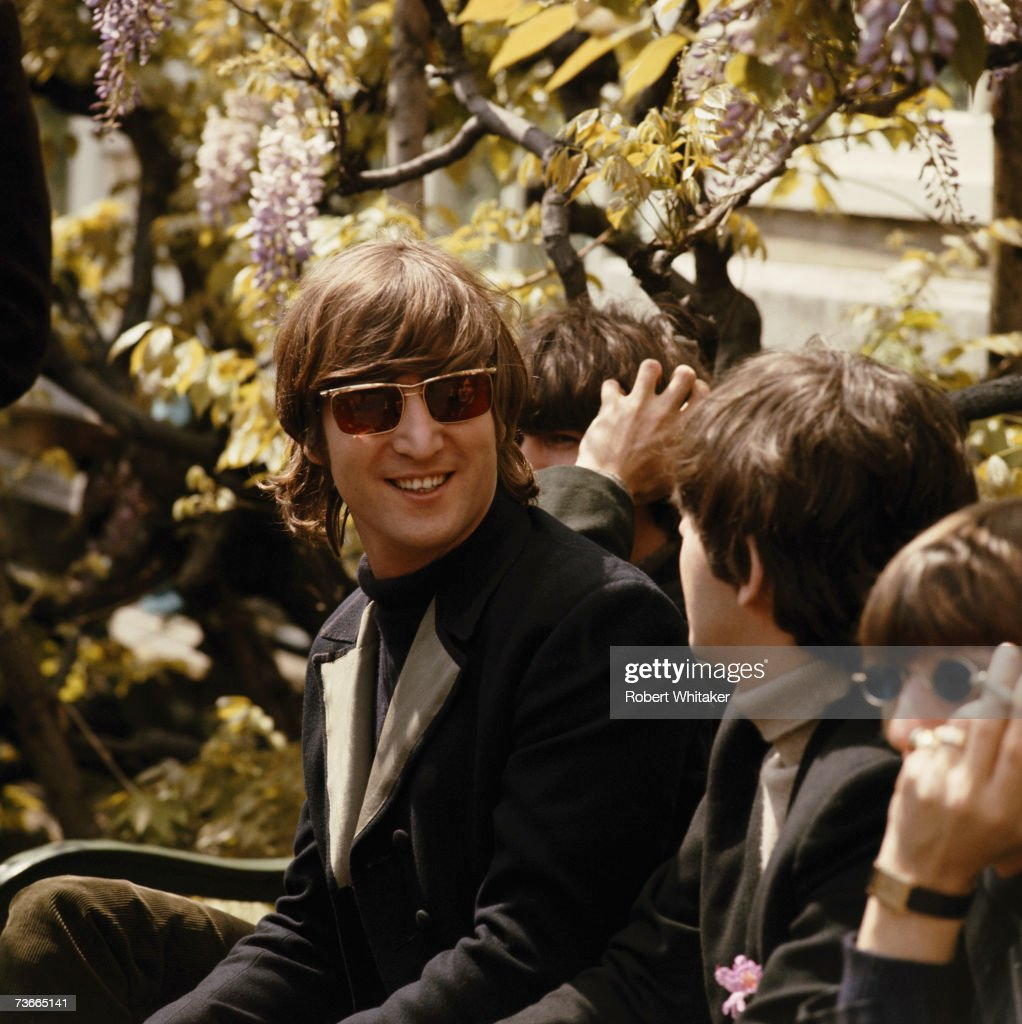 The Beatles in Chiswick House grounds, London, during the making of promotional films for their single 'Rain' and 'Paperback Writer', 20th May 1966. Left to right: John Lennon (1940 - 1980), George Harrison (1943 - 2001), Paul McCartney and Ringo Starr.